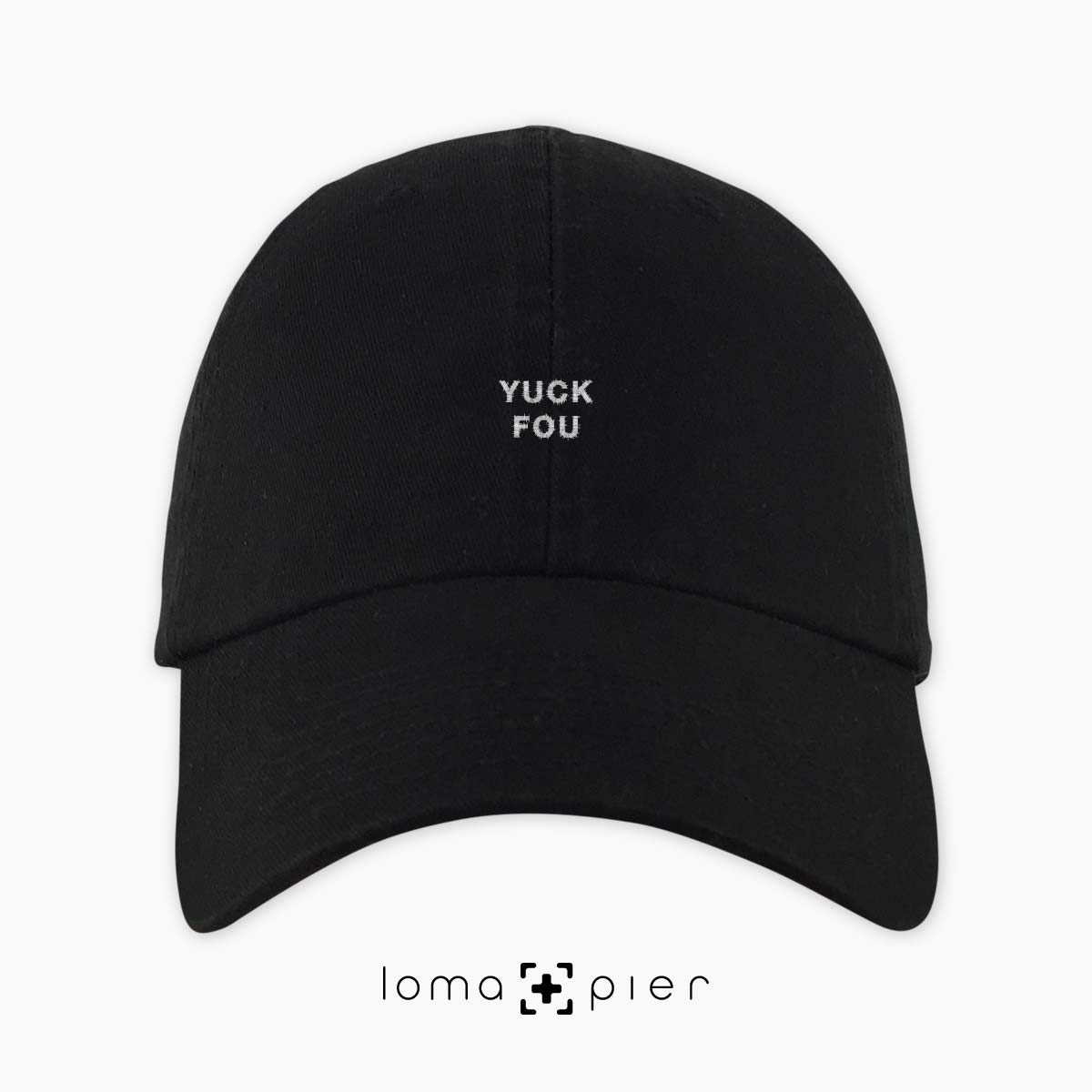 YUCK FOU typography embroidered on a black unstructured dad hat with white thread by loma+pier hat store made in the USA